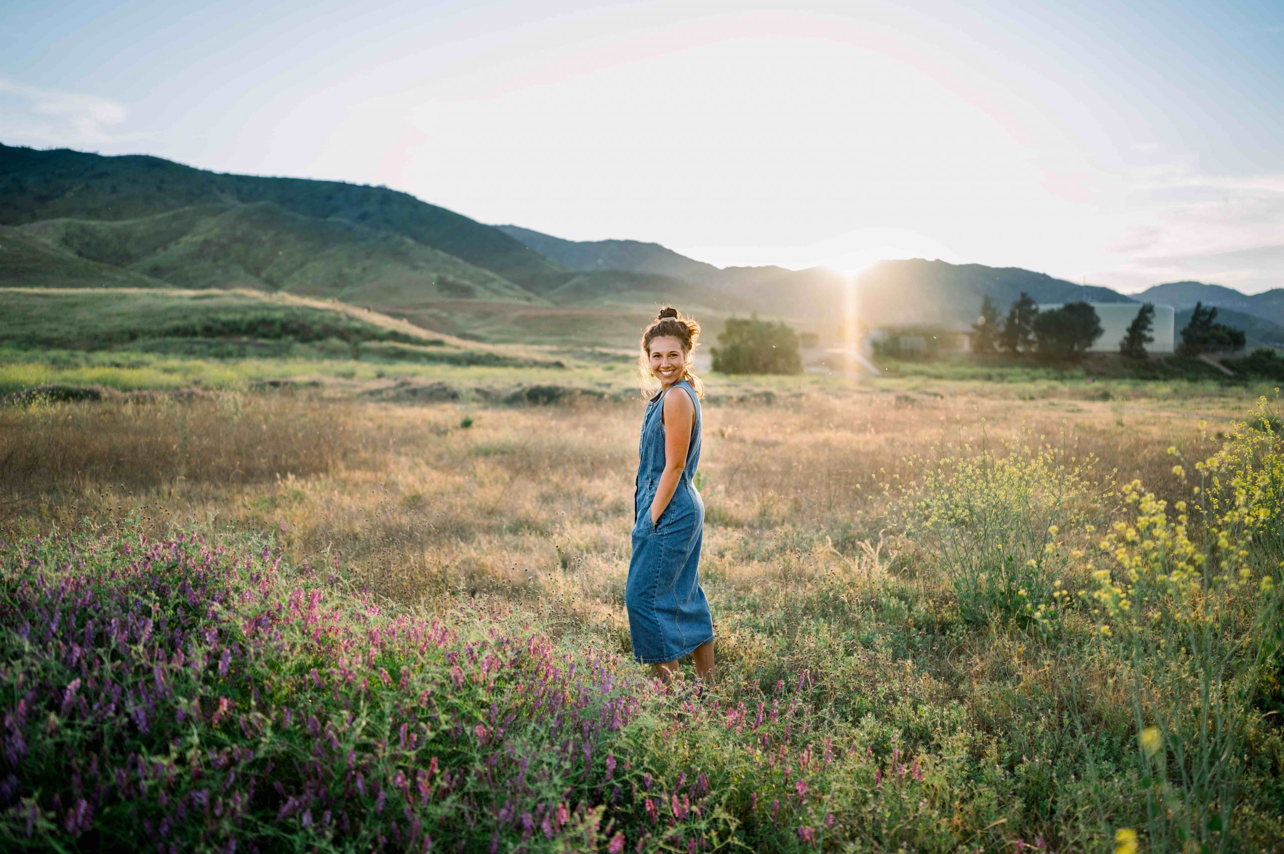 Temecula Senior Photographer captures a high school senior in a field in Murrieta California